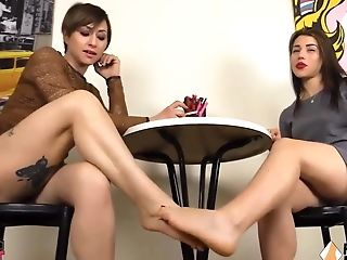 Two Bootlessly Lesbos Playing Footsies